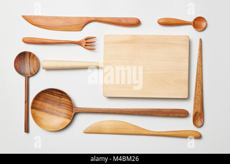 Various kitchen utensil on white wooden background - Stock Photo