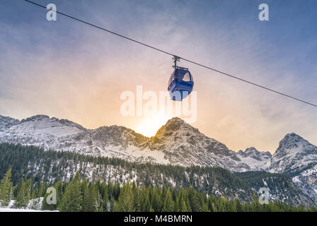 Cable car route over the Alps mountains - Stock Photo
