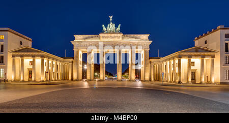 Panorama of the famous Brandenburger Tor in Berlin at night - Stock Photo
