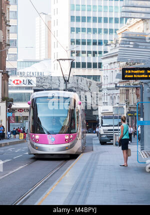 An electric tram in Birmingham City Centre, England - Stock Photo