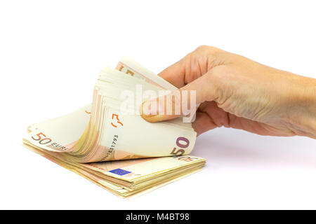 Hand holds pile of fifty euro bills on white background - Stock Photo