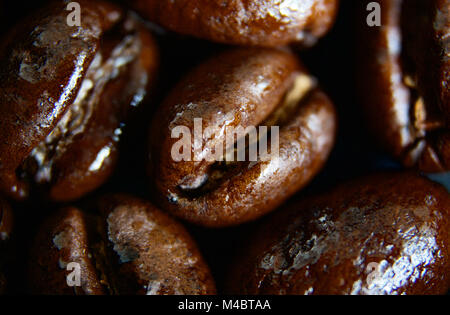 Up-close shot of dark roasted coffee beans - Stock Photo