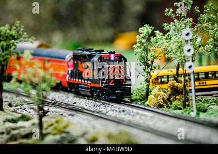 miniature toy model train locomotives on display - Stock Photo