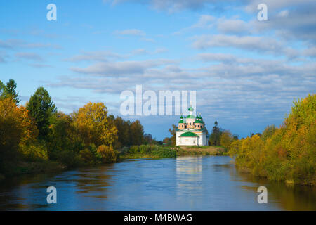 Orthodox church on a river in a sunny autumn day - Stock Photo