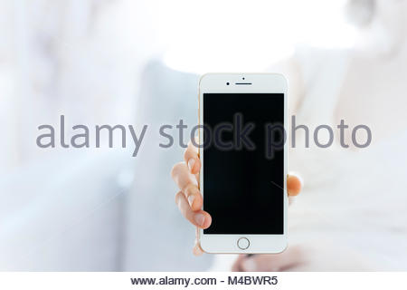 Woman showing the new iPhone 7 plus smartphone - Stock Photo