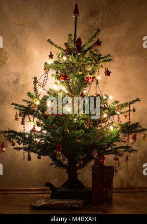 The decorated Christmas tree with stars and Christmas glitter balls - Stock Photo
