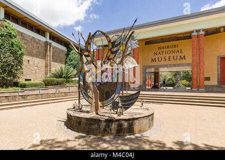 Exterior of the Nairobi National Museum showing an art sculpture in front of the main entrance, Nairobi, Kenya - Stock Photo