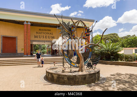 Exterior of the Nairobi National Museum showing an art sculpture in front of the main entrance, Nairobi with visitors - Stock Photo