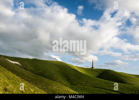 Cherhill Down with the Lansdowne Monument and white horse - Stock Photo