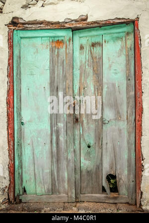 Old damaged wooden doors - Stock Photo