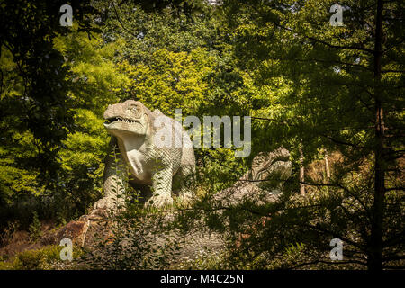 Dinosaur sculpture in a park - Stock Photo