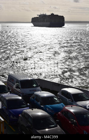 cars on the deck of the isle of wight car ferry being transported accross the solent to the island at sunset with - Stock Photo