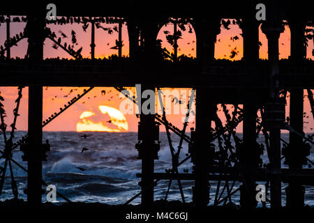 Aberystwyth Wales UK, Thursday 15 Feb 2018  UK Weather:  The setting sun, framed  dramatically behind Aberystwyth - Stock Photo