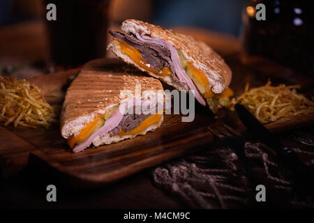 Sandwich food photo. Street food. Fresh tasty grilled burger with homemade craft buns, cooked at barbecue. Big cheeseburger - Stock Photo