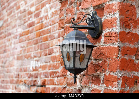 Vintage lantern on old red brick wall - Stock Photo