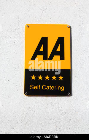 AA 5 Star Self Catering sign on a white wall. Cawsand, Cornwall - Stock Photo