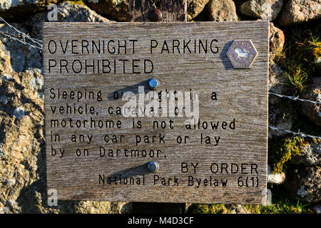 Wooden, Overnight parking prohibition sign on the Devonshire Dartmoor area. - Stock Photo