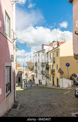Street with colorful and old houses in Lisbon - Stock Photo