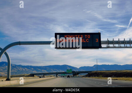 Three minutes to downtown salt lake city on a highway sign. Concept: exciting, can't wait to get to Salt Lake City - Stock Photo
