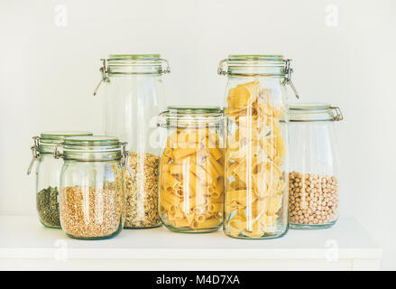 Uncooked cereals, grains, beans and pasta for healthy cooking - Stock Photo