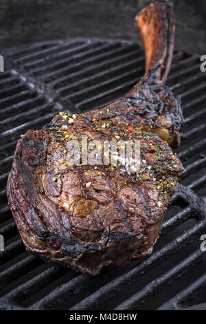 Barbecue Tomahawk Steak on a Grillage - Stock Photo