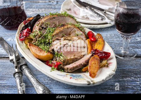 Leg of Lamb with Vegetables and Fruits - Stock Photo
