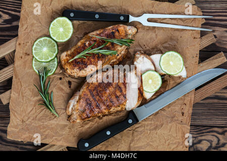 Grilled chicken filet with herbs  on a paper - Stock Photo