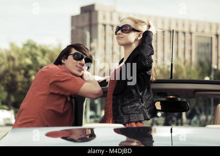 Happy young couple in the car - Stock Photo