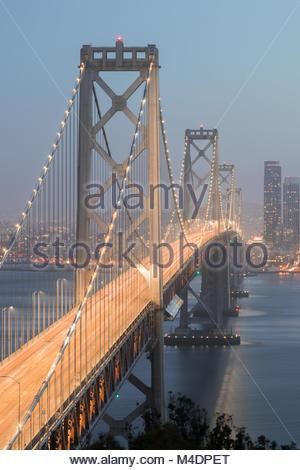 San Francisco's Bay Bridge Close-up on a Foggy Evening. - Stock Photo
