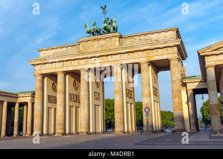 The Brandenburg Gate in Berlin in the early morning sunshine - Stock Photo