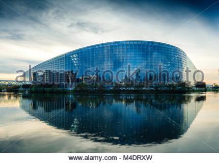 European Parliament building in Strasbourg at dusk - Stock Photo