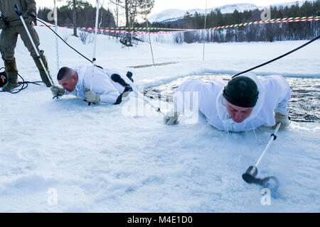 Norwegian Sgt.Maj. Rune Wenneberg, the sergeant major for Norwegian Army, participates in an ice-breaking drill - Stock Photo