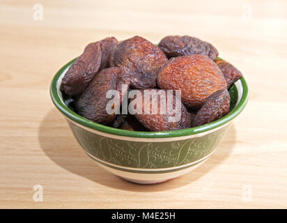 Dried apricots in an oriental bowl - Stock Photo