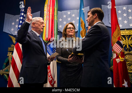 Secretary of Defense James N. Mattis officially welcomed back Army Secretary Dr. Mark T. Esper into the service - Stock Photo