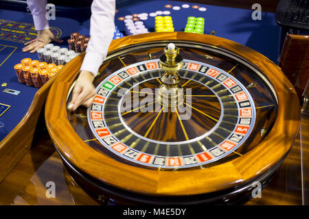 Wooden Roulette table in casino ball - Stock Photo