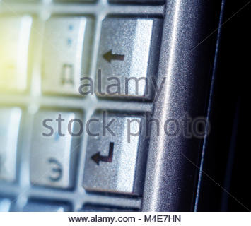 Enter button on old smartphone full qwerty keyb sunbeam - Stock Photo