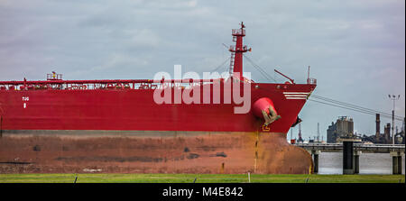 large cargo ship parked in international port - Stock Photo