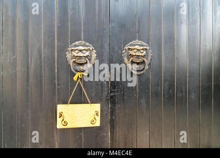 traditional oriental door knocker - Stock Photo & vintage oriental knocker door of metal lion on wood door Stock Photo ...