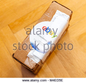 Ebay and Pitney Bowens logo printed on cardboard box delivery - Stock Photo
