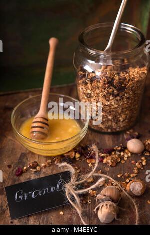 Granola with honey - Stock Photo