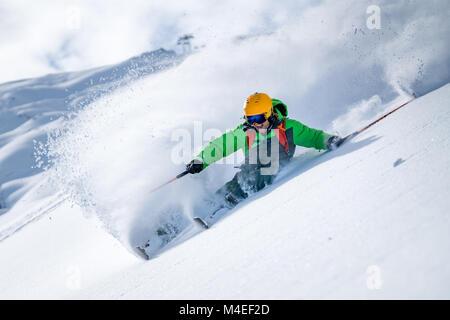 Man skiing in powder snow, Kitzsteinhorn, Salzburg, Austria - Stock Photo