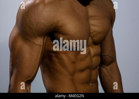 A fitness model torso with the chest muscles tightly flexed. Close up. - Stock Photo