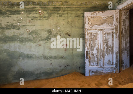 Abandoned ghost town of Kolmanskop in Namibia - Stock Photo