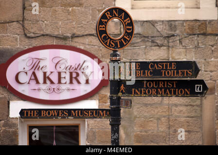 Information sign and cake shop, Barnard Castle, County Durham - Stock Photo