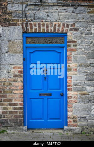 Blue doors of an old home - Stock Photo