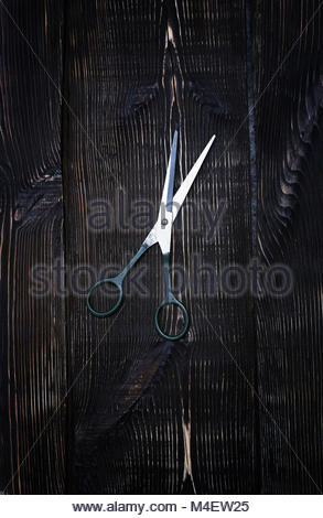 Scissors on a wooden background - Stock Photo