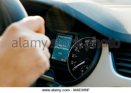 Car computer informing driver about vehicle on wrong carriageway - Stock Photo