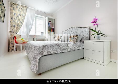 elegant bedroom in soft light colors - Stock Photo