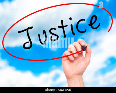 Man Hand writing Justice with black marker on visual screen - Stock Photo