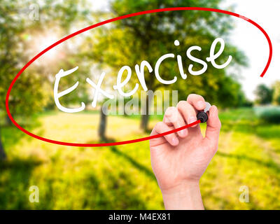 Man Hand writing Exercise with black marker on visual screen. - Stock Photo